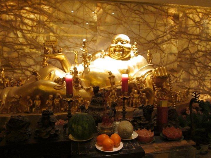 Buddha & offerings at Wahaha Hotel