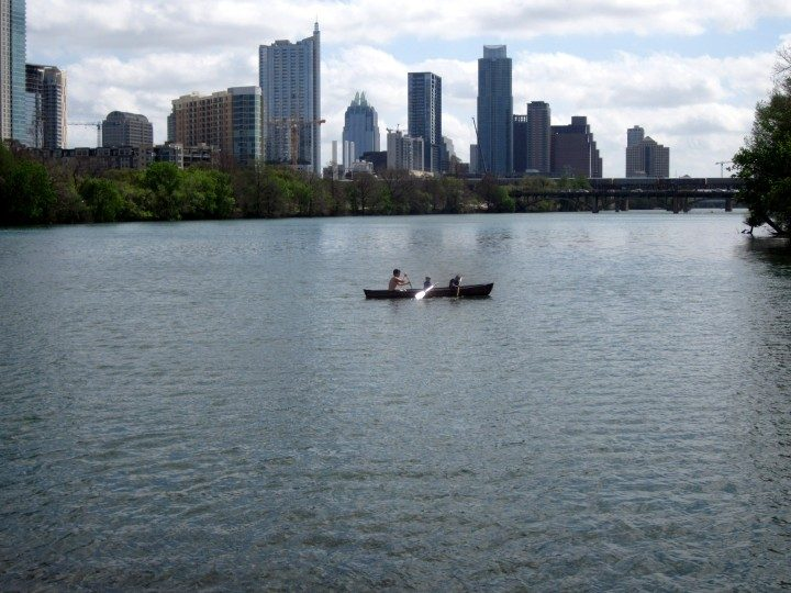 Canoeing with the view of downtown Austin Texas skyline