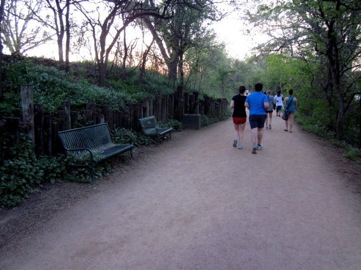 Joggers on the Lady Bird Lake Hike and Bike Trail in downtown Austin Texas
