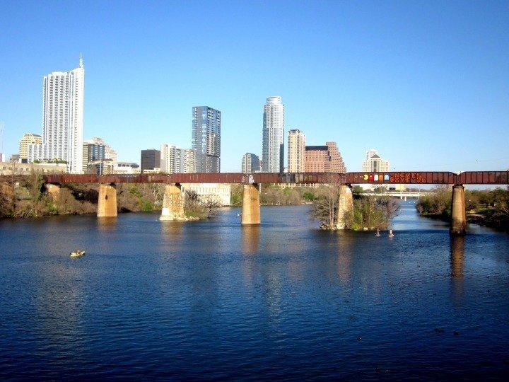 Hiking around Lady Bird Lake - railroad bridge and downtown skyline of Austin Texas
