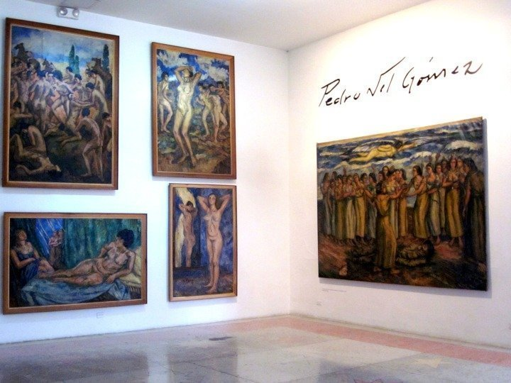 Large paintings at Casa Museo Pedro Nel Gomez in Medellin Colombia