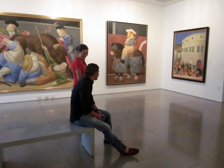 Colombian tourists from Bogota enjoying Botero's paintings at Museo de Antioquia