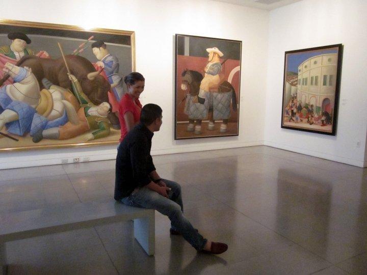 Colombian tourists from Bogota enjoying Botero's paintings at Museo de Antioquia