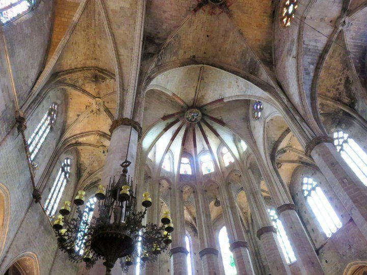 Ceiling at Basilica Santa Maria del Mar in El Born district of Barcelona - outstanding architecture - beautiful stained glass in Barcelona Catalonia Spain