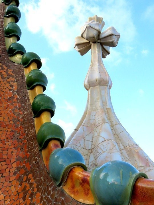Antoni Gaudi's Casa Batllo rooftop dragon in the heart of Barcelona Gracia district