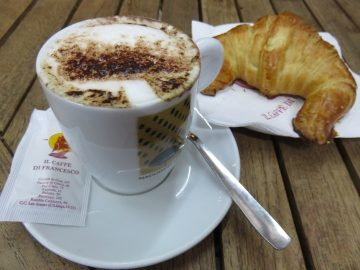 Cortado (espresso with a little warm milk) and a croissant for breakfast in Barcelona Catalonia Spain