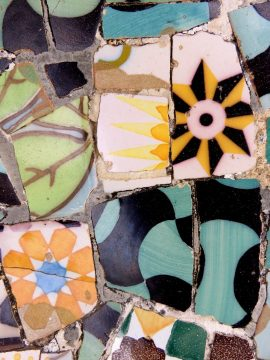 Park Guell trencadis mosaic tile bench designed by Antoni Guadi in Gracia district of Barcelona