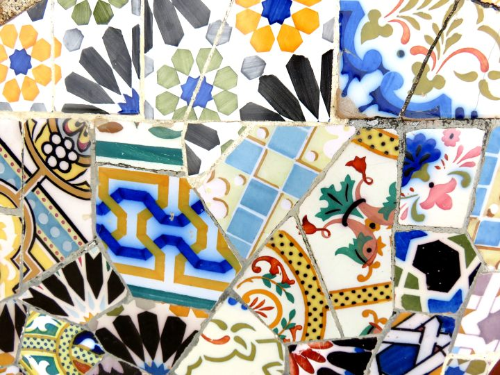 Trencadis style mosaic tile bench designed by Antoni Gaudi at Park Guell in Gracia district of Barcelona