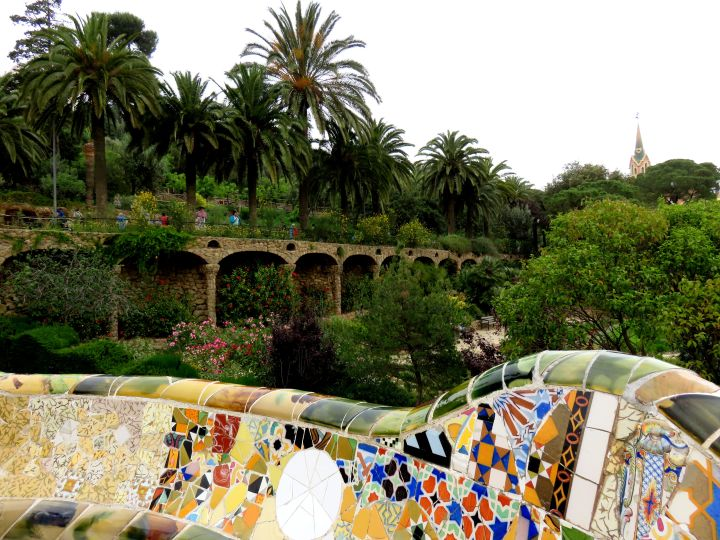 Antoni Gaudi's magnificent Park Guell features mosaic bench overlooking gardens in Gracia district of Barcelona