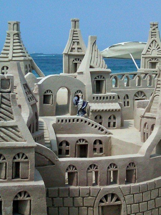 Sand sculpture wizard and his castle - Copacabana beach in Rio de Janeiro Brazil