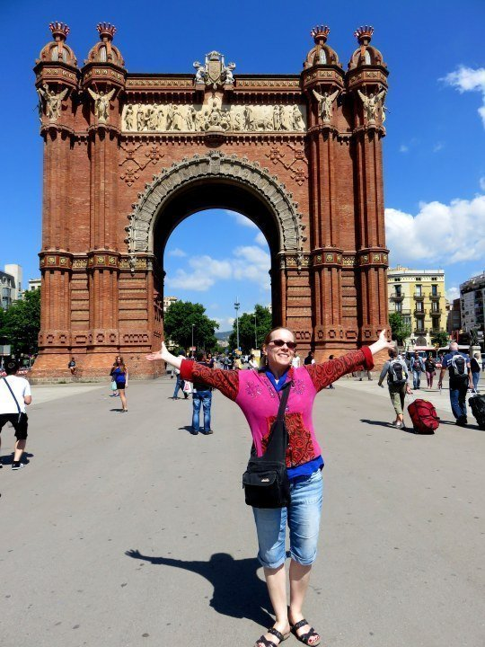 Susan Moore of Solo Trips and Tips visiting the Arc de Triomf in Barcelona Spain