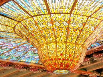 Stained glass dome of Palau de la Musica Catalana in La Ribera neighborhood of Barcelona Spain - concert hall and extraordinary design with stained glass dome