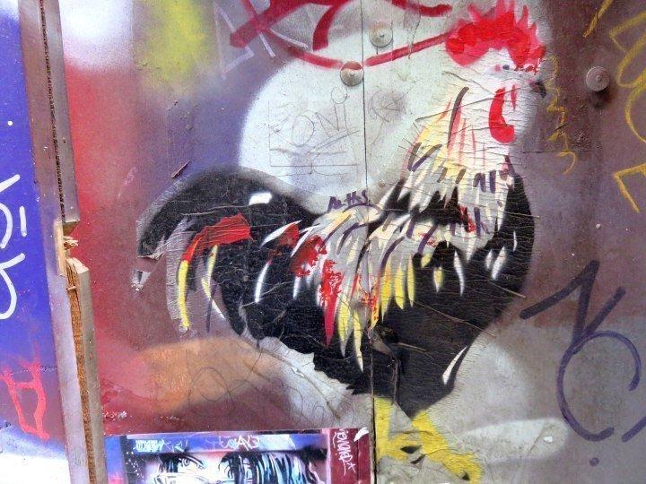 Rooster - street art in central Barcelona Barri Gotic neighborhood