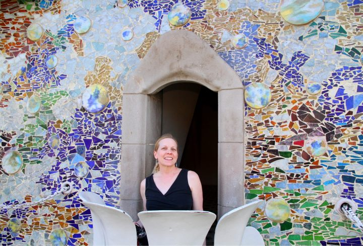 Susan on the balcony of Casa Batllo - designed by Catalan architect Antoni Gaudi - Gracia district Barcelona