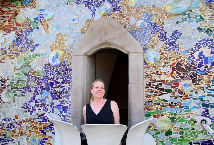Susan on the balcony of Casa Batllo - designed by Catalan architect Antoni Gaudi - Gracia district Barcelona