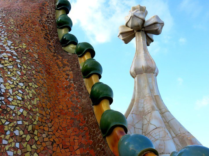 Catalan architect Antoni Gaudi's Casa Batllo rooftop dragon in the heart of Gracia district in Barcelona Spain - Catalonia region