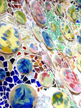 Trencadis mosaic on the terrace of Casa Batllo designed by famous Catalan architect Antoni Gaudi - Gracia district of Barcelona Catalonia Spain