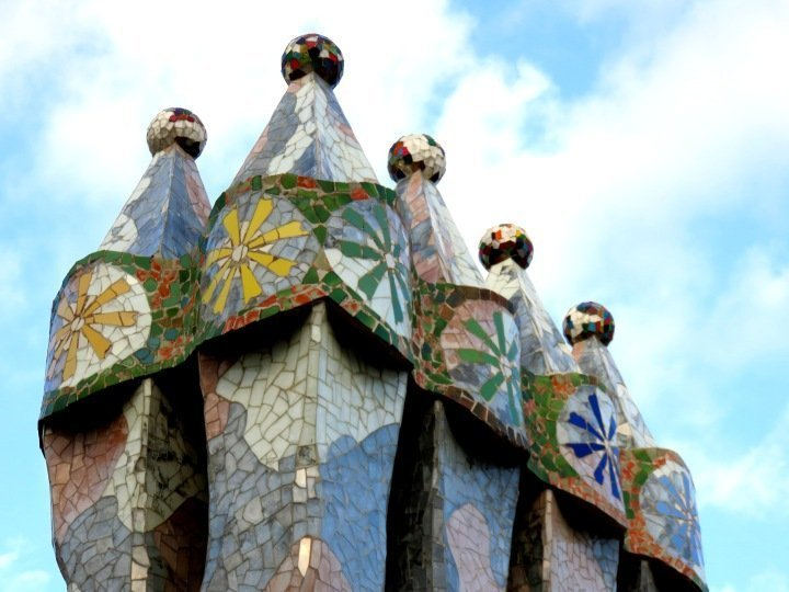 Trencadis mosaic tile chimneys on the roof top of Casa Batllo - Gracia district - Barcelona Catalonia Spain