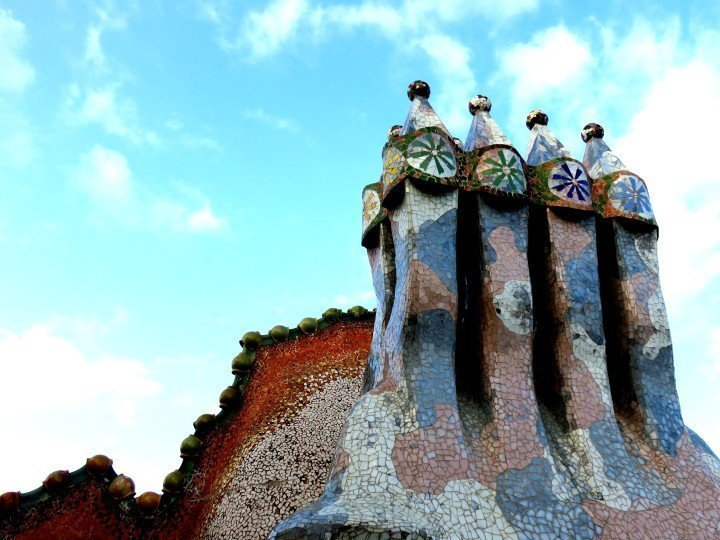 Catalan architect Antoni Gaudi's Casa Batllo trencadis mosaic tile chimneys and dragon on the roof top - Gracia district Barcelona Catalonia Spain