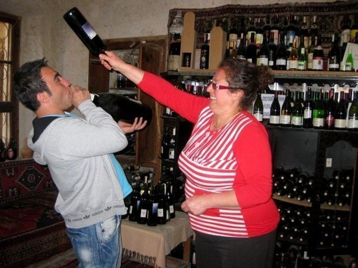 Wine merchant with a joyful personality and sense of humor at Mahzen Sarap Evi wine shop in Urgup