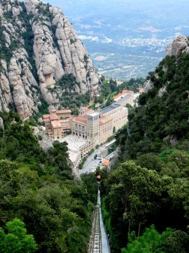 View of Benedictine monastery of Santa Maria de Montserrat - cable car or funicular up the Montserrat mountain