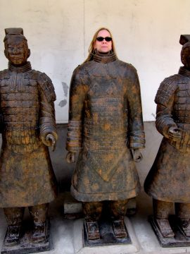 Susan masquerades as warrior ini Xi'an China at the Museum of Qin Terracotta Warriors and Horses