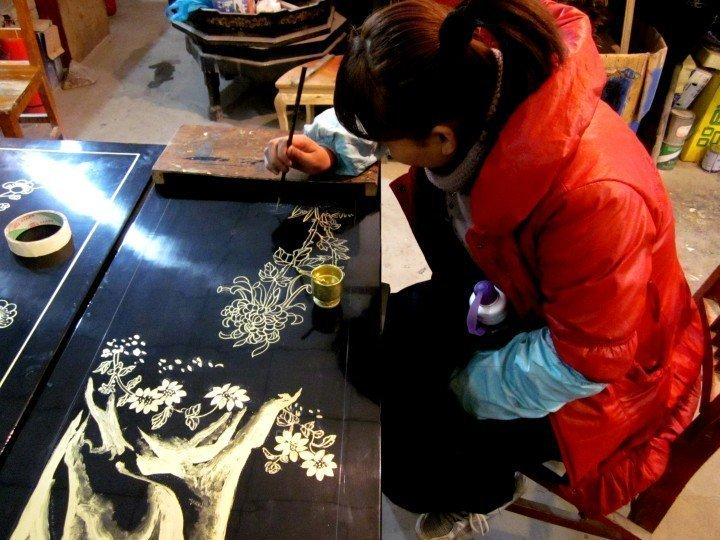 Artisan working on lacquer designs in Xi'an China - Shaanxi province