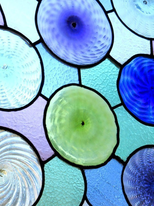 Casa Batllo stained glass windows in wood frames - Catalan architect Antoni Gaudi - Passeig de Gracia district in Barcelona
