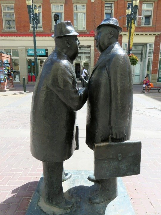 Calgary Alberta public art - Conversation by William McElcheran - located at 8th Ave and 1st Street SW