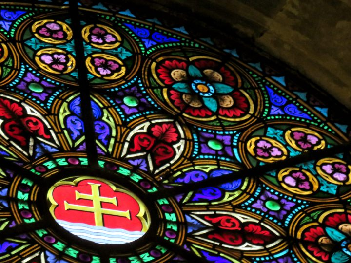 Detail of stained glass window at Santa Anna Church near Plaza Catalunya in the Gothic quarter of Barcelona Spain
