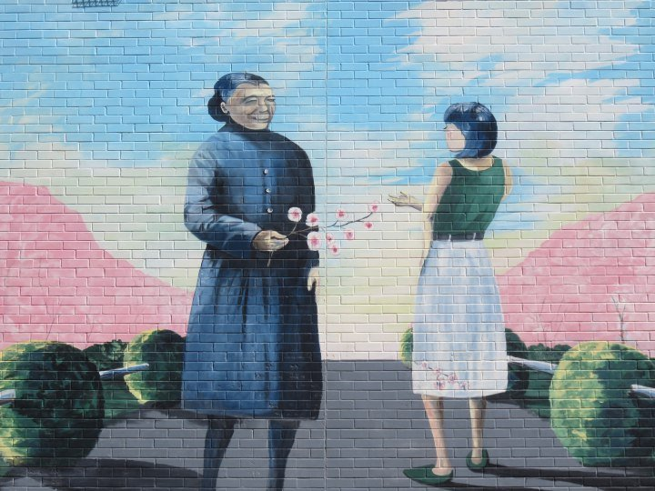 Passing the wisdom of the old to the young - mural by Dale Barry in Calgary's Chinatown