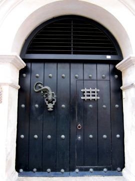Doors with fancy doorknockers in the old walled city of Cartagena Colombia on the Caribbean coast