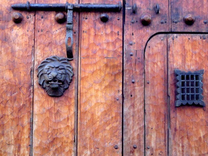 Beautiful textured door adorned with lion's head - Cartagena Colombia old walled city on the Caribbean coast
