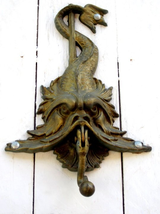 Elaborately doorknockers feature on many doors in old walled city of Cartagena Colombia
