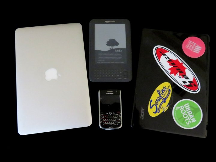 Travel gear and electronic essentials - MacBook Air, Acer laptop, Blackberry mobile phone, Kindle 3G wireless access