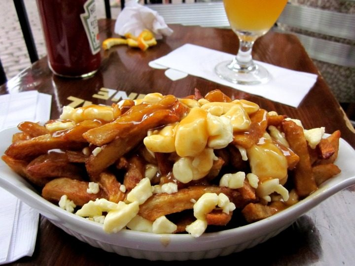 Poutine Quintessential Quebec Cuisine - French fries, cheese curds, topped with gravy
