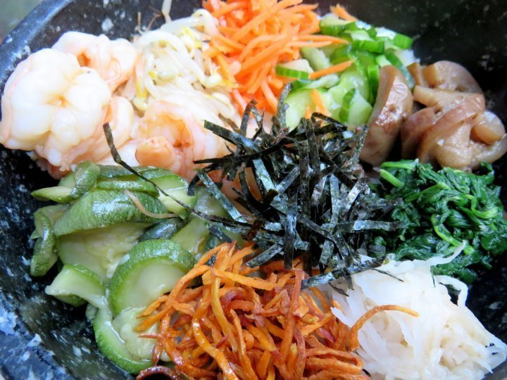 Dolsot bibimbap served in a sizzling hot stone bowl at Koreana restaurant in Montreal Quebec