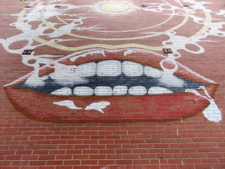 Mouth with smoke - street art in central Montreal Quebec