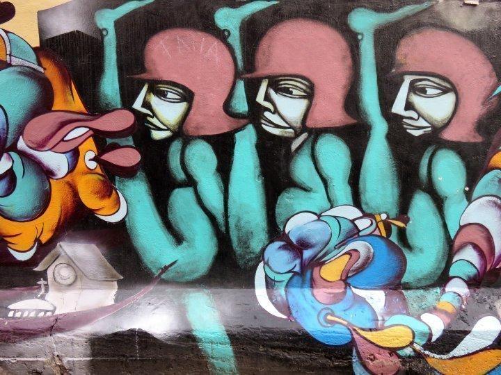 Walk St Denis Street in Montreal Quebec for street art murals, restaurants, shops, art galleries