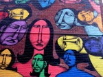 Women's faces in bright colors make up this street art mural on St Denis Street in Montreal Quebec Canada
