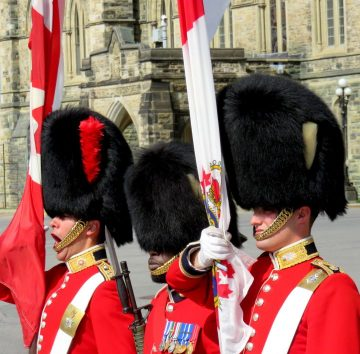 Colorful uniforms of Ceremonial Guard at Ottawa's Parliament Hill Changing of the Guard