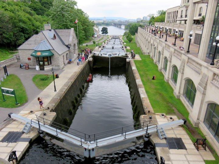 Canoe locking through 8 locks Rideau Canal