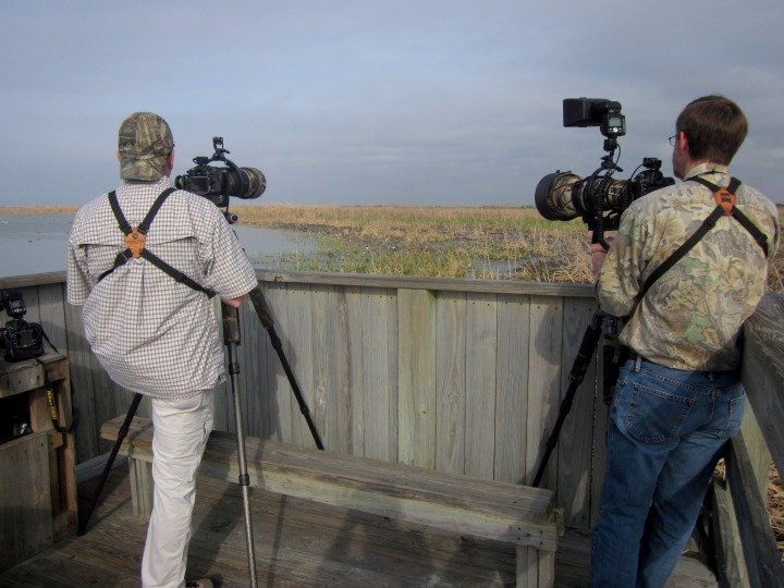 Set up with their professional camera gear - birders awaiting some action at Port Aransas Leonabelle Turnbull Birding Center