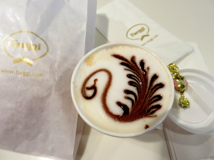 Cappuccino and pastry at Farggi cafe across the street from Sagrada Familia in Barcelona Spain