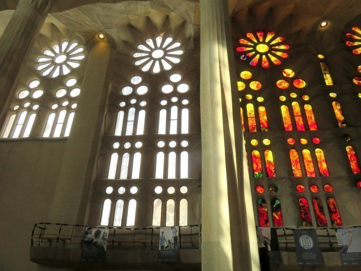 Construction of Sagrada Familia began in 1882 and continues - stained glass windows
