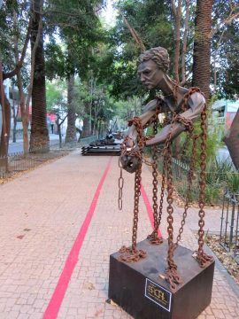 La Condesa Mexico City - sculpture of a man wrapped in chains - Jose Sacal - Amsterdam Avenue pedestrian walkway