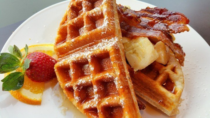 The Coastal Cafe - The Elvis consists of buttermilk waffles, bacon, bananas, and peanut butter, and maple syrup