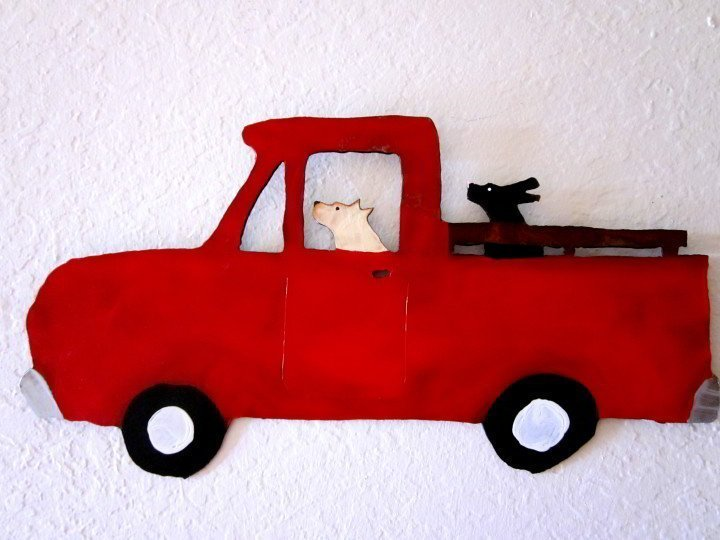 Dogs joyriding in pickup truck by Wisconsin artist Teresa Bouzek