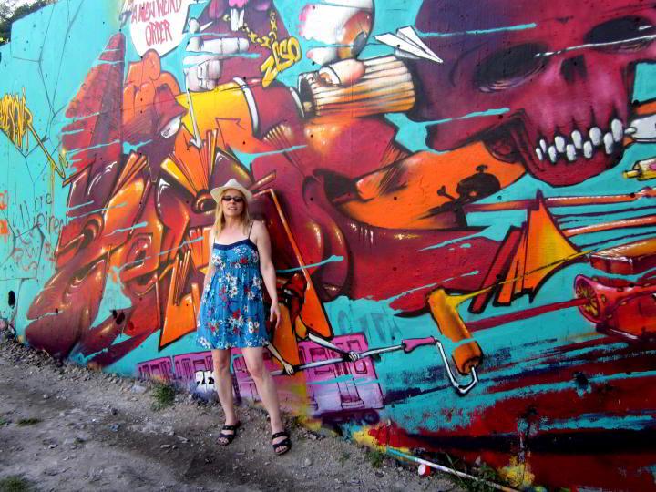 Graffiti wall Austin Texas - Susan Moore in front of graffiti mural