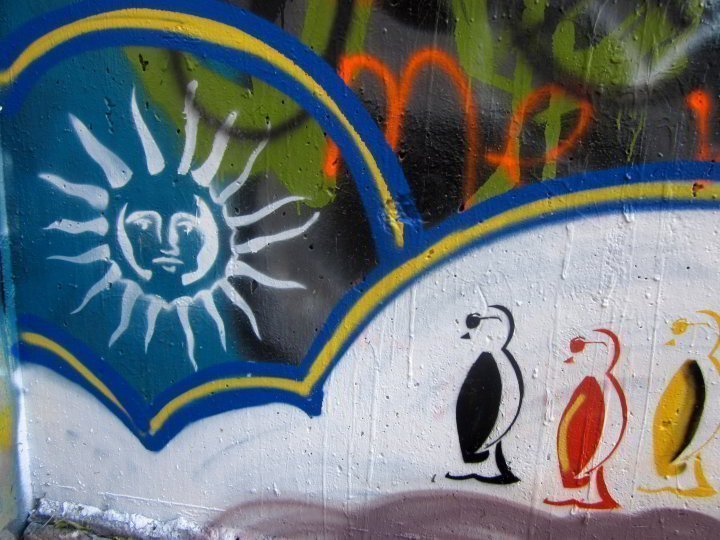 Graffiti wall Austin Texas - Penguins wearing sunglasses enjoying some sun at the Castle Hill graffiti park known as Hope Outdoor Gallery